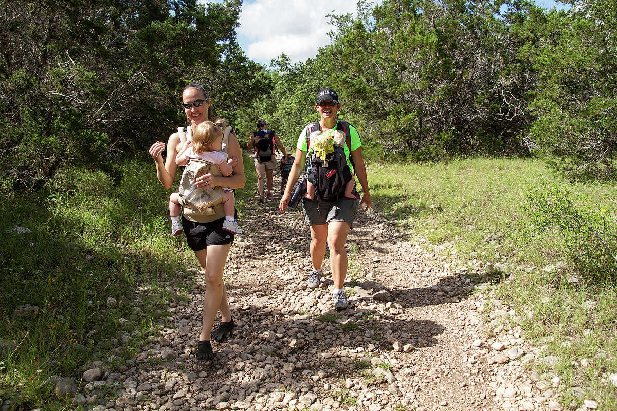 (Left to right) Jennifer Caulk and Jennifer Ward carry their children while hiking with the Hike It Baby San Antonio group, Saturday, June 6, 2015, at Government Canyon State Natural Area.