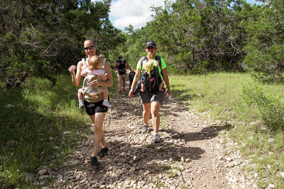 (Left to right) Jennifer Caulk and Jennifer Ward carry their children while hiking with the Hike It Baby San Antonio group, Saturday, June 6, 2015, at Government Canyon State Natural Area. Photo: Alma E. Hernandez,  For The San Antonio Express News / Alma E. Hernandez / For The San