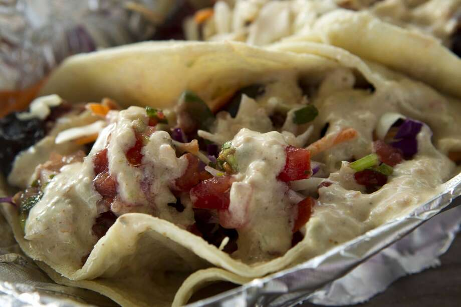 Corkscrew BBQThis Spring barbeque joint makes a killer pulled pork taco that is topped with green chili ranch dressing and fresh pico de gallo.Coming soon to 26608 Keith in Spring. Photo: Brett Coomer, Houston Chronicle