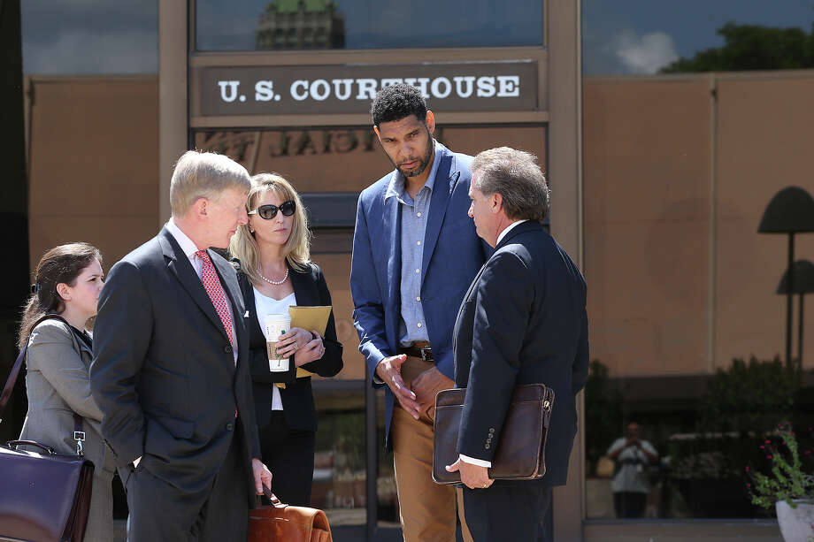 Tim Duncan consults with his legal team after he makes an appearance in federal court before U.S. District Judge Xavier Rodriguez regarding his lawsuit against Charles Banks on June 10, 2015. From left are attorney Jacqueline Garza-Rothrock, attorney J.Tullos Wells, founder and president of Predico Partners Wendy Kowalik, Duncan and attorney Michael D. Bernard. Photo: Tom Reel /San Antonio Express-News