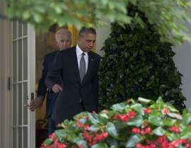 President Barack Obama, joined by Vice President Joe Biden, walks from the Oval Office to speak in the Rose Garden of the White House, Thursday, June 25, 2015, in Washington, about that the U.S. Supreme Court upheld the subsidies for customers in states that do not operate their own exchanges under President Barack Obama's Affordable Care Act. (AP Photo/Carolyn Kaster)
