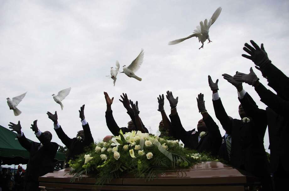 Pallbearer release doves over the casket holding Emanuel AME Church shooting victim Ethel Lance during her burial at the Emanuel AME Church Cemetery in Charleston, South Carolina, June 25, 2015. Photo: JIM WATSON, AFP / Getty Images / AFP