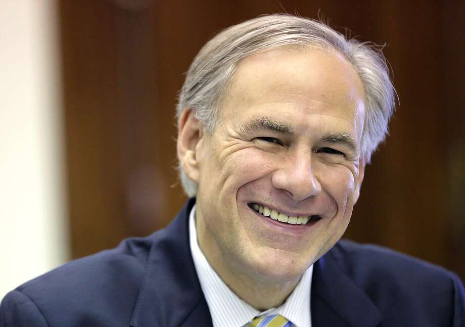 Texas Gov. Greg Abbott shares a laugh with news reporters during a round table talk in his office at the Texas Capitol, Wednesday, June 3, 2015, in Austin, Texas. (AP Photo/Eric Gay) Photo: Eric Gay, Associated Press