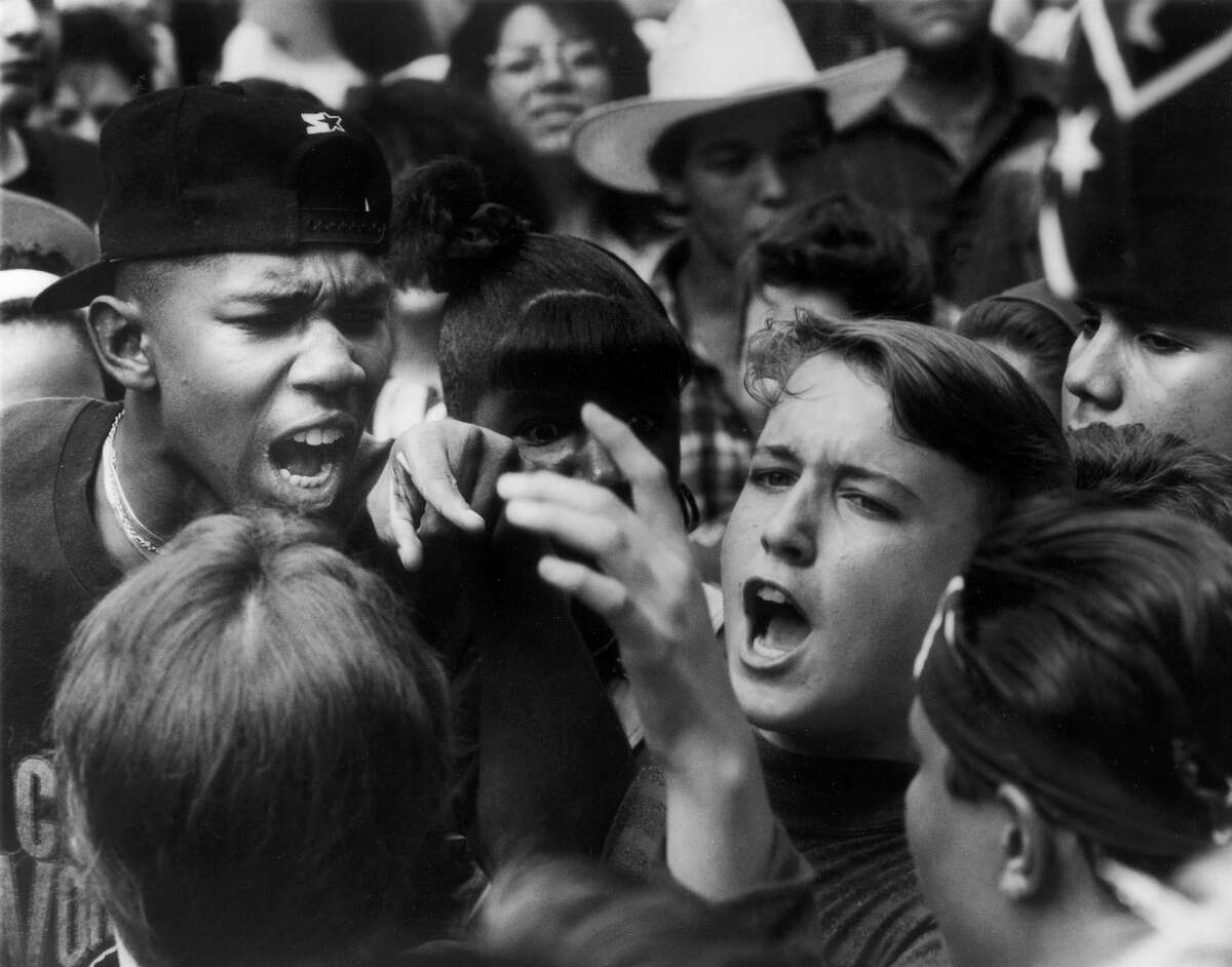 Robert E. Lee High School protest of use of Confederate flag for the school's symbol. Students argue among themselves during a protest after school Wednesday May 22 , 1991.