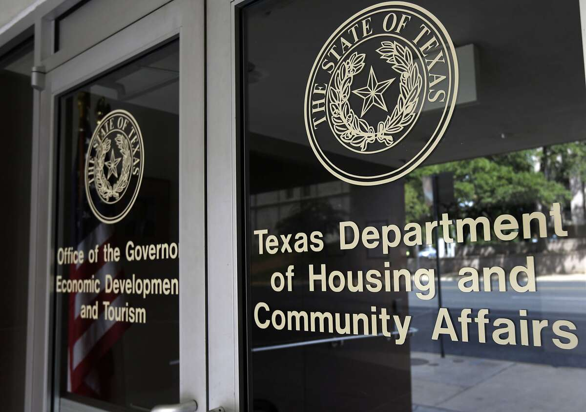 FILE - In this Aug. 30, 2014 file photo, the Texas Department of Housing and Community Affairs is seen in Austin, Texas. The Supreme Court handed a major victory to the Obama administration and civil rights groups on Thursday when it upheld a key tool used for more than four decades to fight housing discrimination. The justices ruled 5-4 that federal housing laws prohibit seemingly neutral practices that harm minorities, even without proof of intentional discrimination. The case involved an appeal from Texas officials accused of accused of violating the Fair Housing Act by awarding federal tax credits in a way that kept low-income housing out of white neighborhoods.