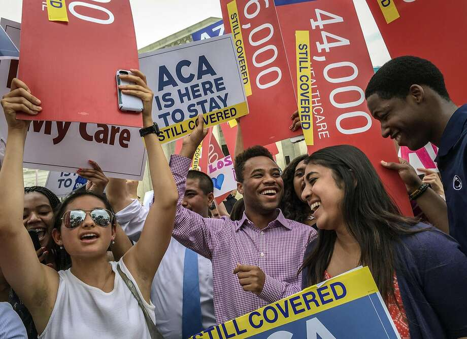Students from around the country celebrate in front of the Supreme Court in Washington on June 25 after the justices upheld a key provision of the Affordable Care Act.