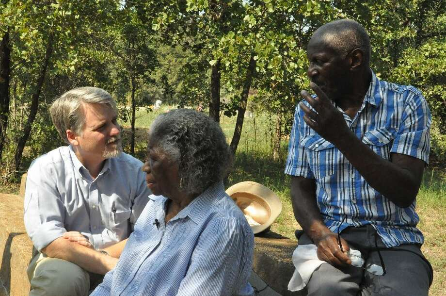 Chris Tomlinson, left, discusses his family's history with Lizzie Mae and Charles Tomlinson, siblings who once worked as sharecroppers on the former Tomlinson Hill slave plantation. They were sitting on the steps of the former Tomlinson Negro School in Falls County, Texas, 150 miles northwest of Houston. Photo: Shalini Ramanathan / Courtesy Chris Tomlinson