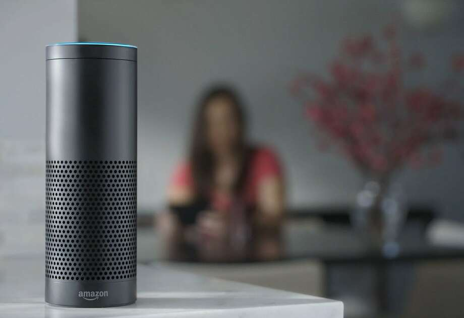 This product image provided by Amazon shows the Amazon Echo speaker. The biggest feature in Amazon's Echo speaker is a voice-recognition system called Alexa that is designed to control Pandora, Amazon Music and Prime Music services as well as give information on news, weather and traffic.Click through the following slideshow to see the top products from Amazon, Apple, and more. Photo: Uncredited, Associated Press