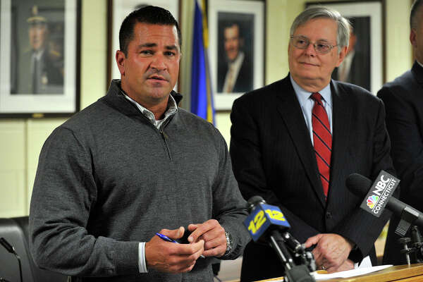 Stamford Police Lt. Diedrich Hohn, left, speaks as Mayor David Martin looks on at Stamford Police Headquarters in Stamford, Conn., on Thursday, Nov. 13, 2014. On Thursday morning Robert Aillery, owner of Stright Septic, surrendered himself to authorities. Aillery was charged with three counts of first degree larceney after an 18-month investigation into his alleged evasion of paying disposal fees to the WPCA for dumping sewage into the city's sewer system. Police say the illegal disposal of sewage affected Aillery's neighbors who complained of bad smells and backflows of sewage into some homes.