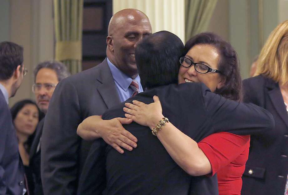 Dr. Richard Pan, pediatrician and senator representing Sacramento, gets a hug from assembly woman Lorena Gonzalez, D-San Diego, as senate bill 277 is passed at the California state capitol building in Sacramento, Calif., on Thursday, June 25, 2015.  Behind at left is assemblyman Jim Cooper, D-Elk Grove. This bill would end California's vaccine exemption loophole and boost immunization rates at California schools. Photo: Liz Hafalia, The Chronicle
