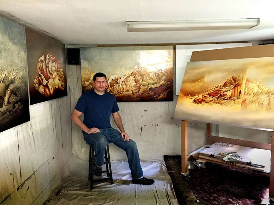 "San Antonio painter Russell Stephenson works on his ""life-sized"" abstract landscapes in his small Alamo Heights studio. Photo: Courtesy Of The Artist / Courtesy Of The Artist"