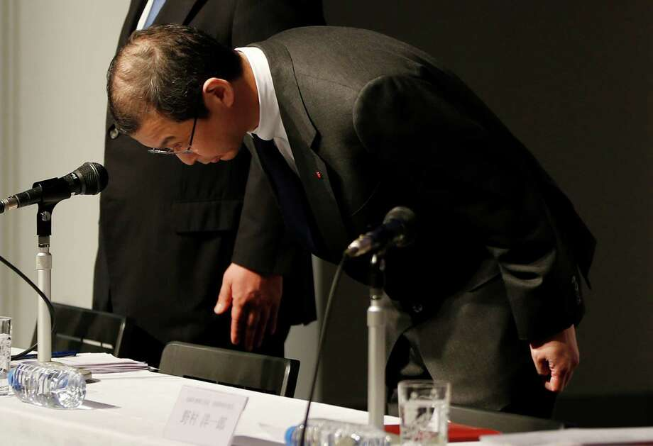 Shigehisa Takada, chairman and CEO of Japanese seat belt and air bag maker Takata Corp., bows in apology during a Tokyo news conference Thursday regarding the expanding recall of his company's air bags, but he said his firm's products were essentially safe. At least eight deaths have been linked to the air bags. Photo: Shuji Kajiyama, STF / AP