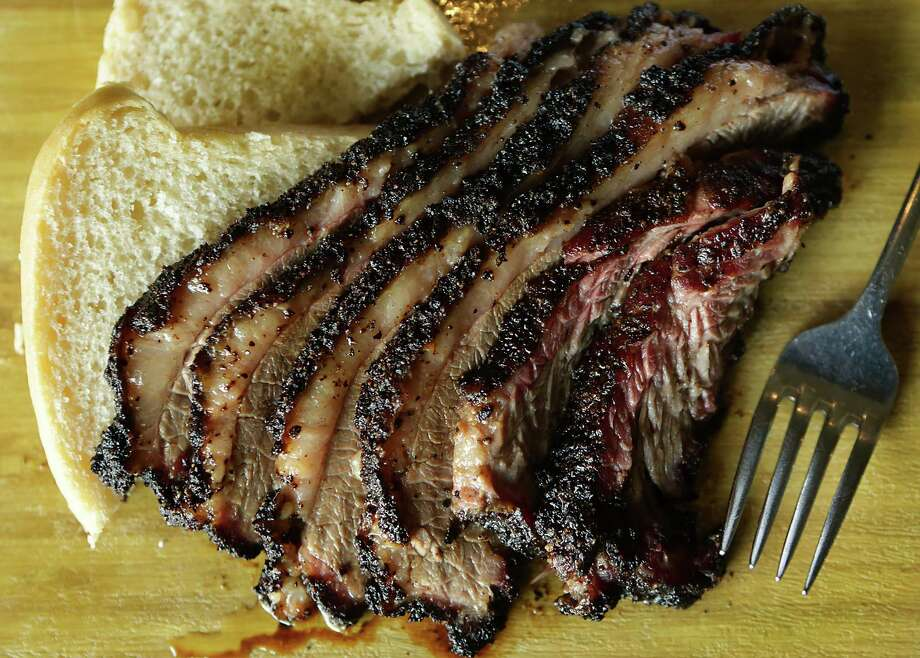Smoke's excellent brisket is served by itself on a wooden board, in a sloppy Joe and as part of the Urban Cowboy BBQ Burger with bacon. Photo: Photos By Bob Owen /San Antonio Express-News / San Antonio Express-News