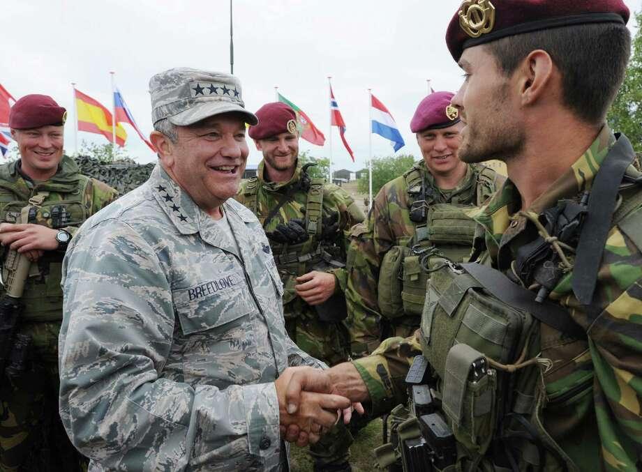 Supreme Allied Commander Europe U.S. Gen. Philip M. Breedlove speaks with a soldier of the Royal Dutch Army after the NATO Noble Jump exercise on a training range near Swietoszow Zagan, Poland, Thursday, June 18, 2015. (AP Photo/Alik Keplicz) Photo: Alik Keplicz, STR / AP