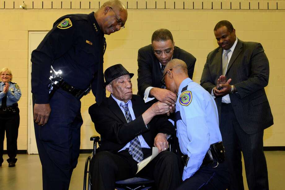 Retired police officer Edward Alfred Thomas, in wheel chair,will have the downtown police headquarters named after him for his yers of service and impact he made as one of the department's first black officers. (Photo courtesy HPD) Photo: Photo Courtesy Of The Houston Po / Photo courtesy of the Houston Po