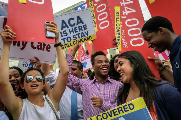 Students from around the country celebrate in front of the Supreme Court in Washington after the justices upheld a key provision of the Affordable Care Act.  (Bill O'Leary / Washington Post)