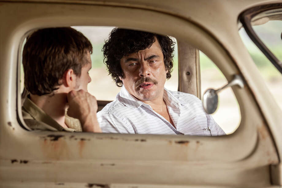 Benicio Del Toro (right), with Josh Hutcherson, gives a chilling performance as drug lord Pablo Escobar in iEscobar: Paradise Lost.i Illustrates FILM-ESCOBAR-ADV27 (category e), by Michael OíSullivan © 2015, The Washington Post. Moved Wednesday, June 24, 2015. (MUST CREDIT: RADIUS.) Photo: HANDOUT / THE WASHINGTON POST