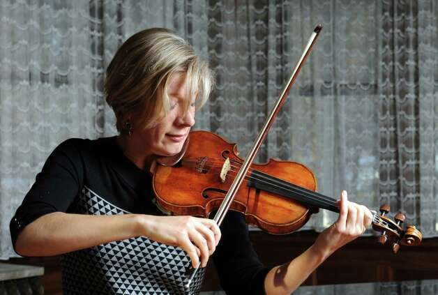 """Classical violinist Elizabeth Pitcairn, director of the Luzerne Music Center and owner of the Red Violin, plays the 1720 """"Red Mendelssohn"""" Stradivarius on Friday Jan. 16, 2015 in Albany, N.Y. (Michael P. Farrell/Times Union) Photo: Michael P. Farrell / 00030197A"""