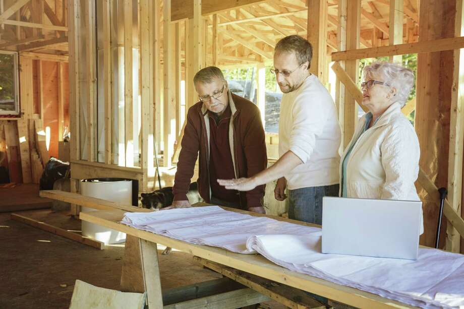 Avoid a misunderstanding with your construction project by filling out a change order form when adjustments are needed. Architect explaining residential construction stages Photo: Getty Images / Vetta