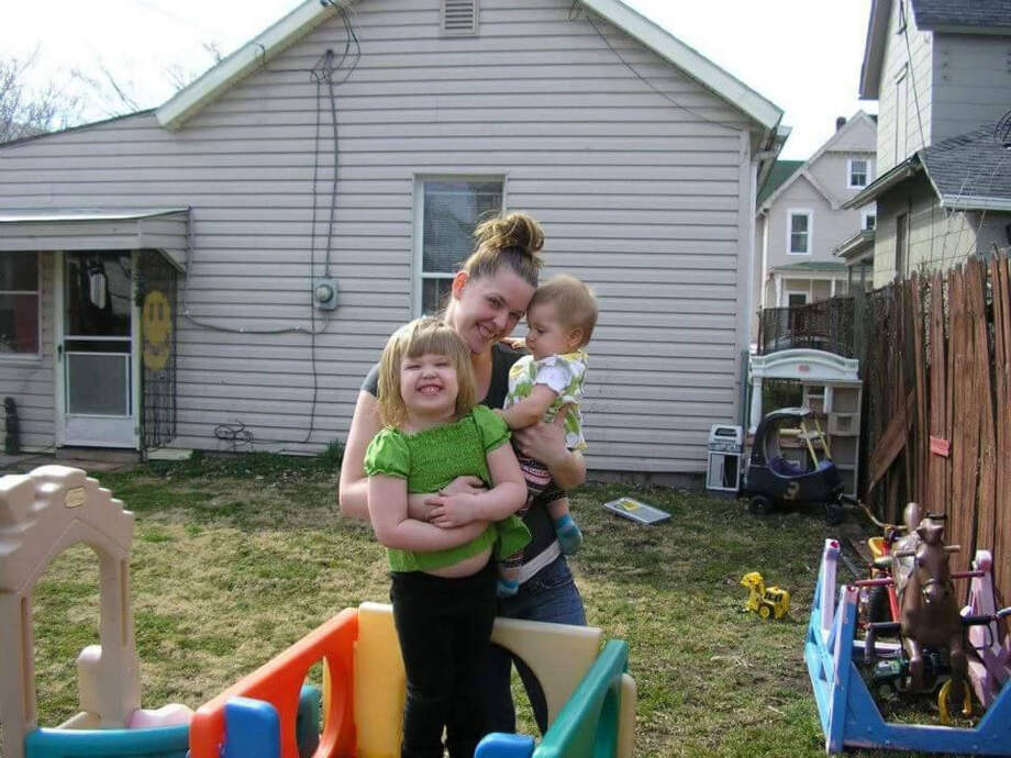Tiffany Sayre of Chillicothe, Ohio, is shown with her two children. Sayre went missing in May and her body was discovered June 20. She is among six women who have gone missing in and near the town of 21,000, prompting fear of a possible serial killer. The FBI have joined the investigation.
