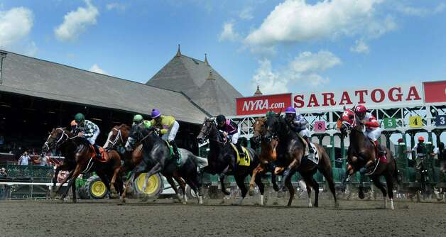 Horses break the gate for the first race of the 2014 Saratoga Race Course meeting Friday afternoon July 18, 2014 in Saratoga Springs, N.Y.    (Skip Dickstein / Times Union) Photo: SKIP DICKSTEIN