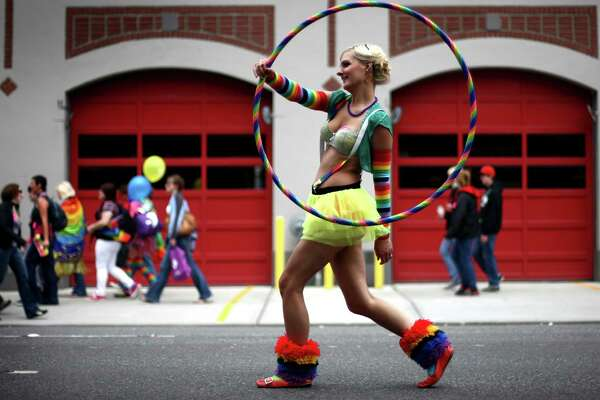 Evelyn Kennedy marches with a hula hoop during Seattle's annual Gay Pride Parade on Sunday, June 24, 2012. (AP Photo/seattlepi.com, Joshua Trujillo)