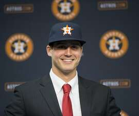 Newly signed Houston Astros pitcher Mark Appel smiles during a news conference Wednesday, June 19, 2013 in Houston, to announce his signing. Appel was selected with the first overall pick in the 2013 MLB First-Year Player Draft. (AP Photo/David J. Phillip)