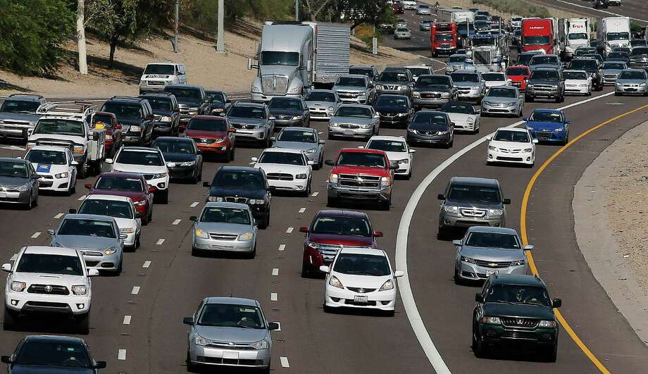 An estimated 41.9 million people will travel 50 miles or more from home during the Independence Day holiday weekend, up 0.7 percent from last year and the most since 2007, according to travel agency and car lobbying group AAA. Photo: Ross D. Franklin /Associated Press / AP