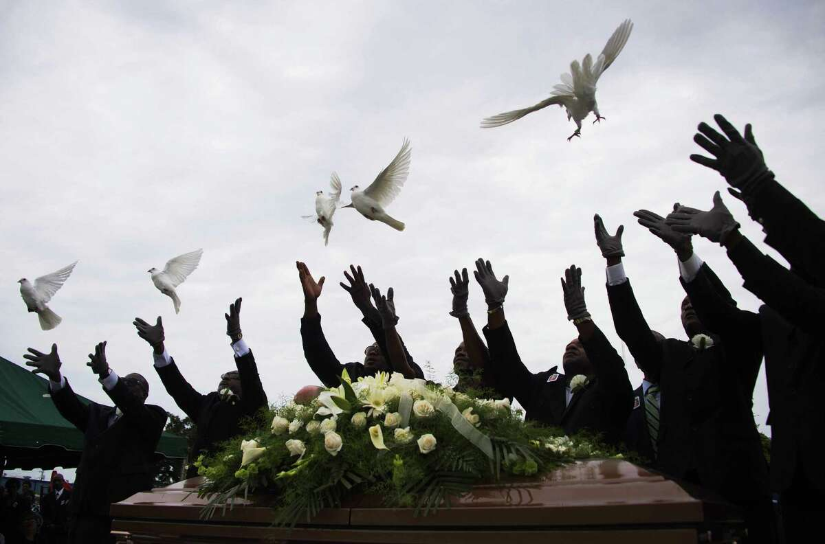 Pallbearers release doves Thursday over the casket of Emanuel AME Church shooting victim Ethel Lance, 70, during her burial in Charleston, S.C. She served as a church sexton for five years.