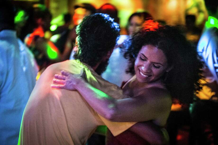Dancers dance salsa as Isis Rosario and her band perform onstage at Luna in San Antonio on June 24. The salsa night is held every other Wednesday at Luna. Photo: Matthew Busch /For San Antonio Express-News / © Matthew Busch