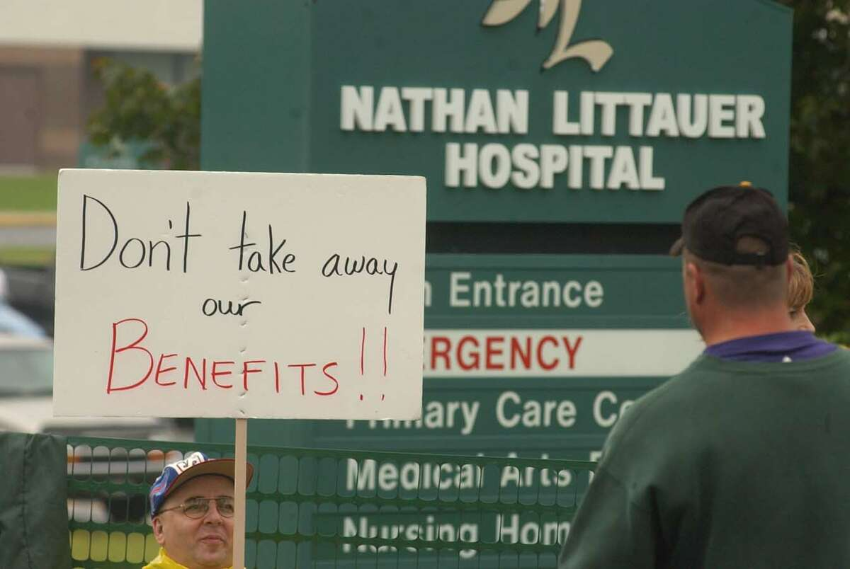 Members of the NYS Human Services Union demonstrate outside Nathan Littauer during a 2004 strike. Officials at the Gloversville hospital threatened to replace unionized nurses should they decide to strike over a contract dispute and wage freeze that has dragged on for about 18 months. (Steve Jacobs/Times Union archive)