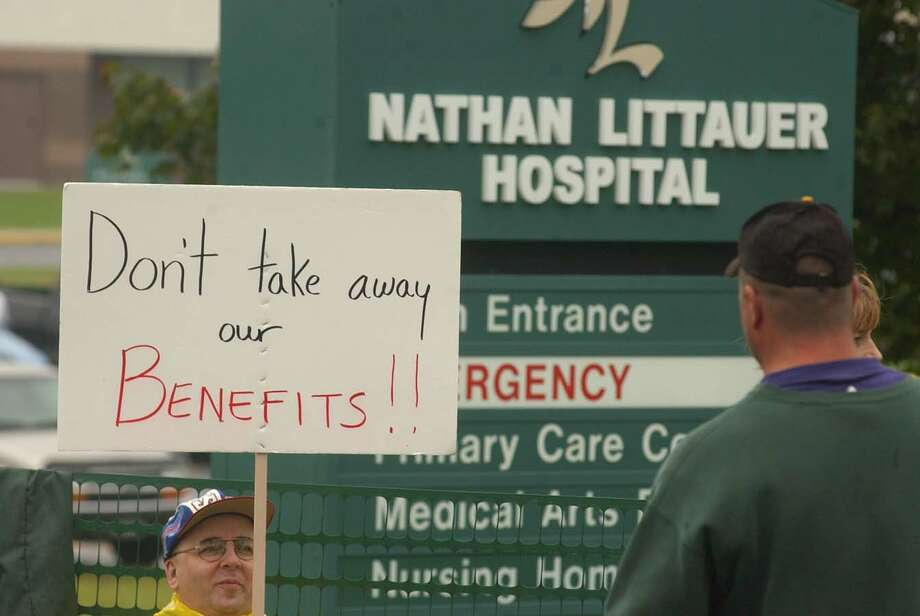 Members of the NYS Human Services Union demonstrate outside Nathan Littauer during a 2004 strike. Officials at the Gloversville hospital threatened to replace unionized nurses should they decide to strike over a contract dispute and wage freeze that has dragged on for about 18 months. (Steve Jacobs/Times Union archive) Photo: STEVE JACOBS / ALBANY TIMES UNION