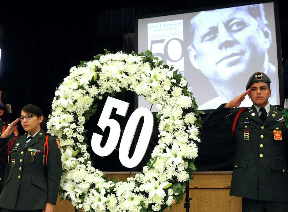 """John F. Kennedy High School JROTC members Francine Sotello, 16 and Daniel Garcia, 16, salute during the playing of """"Taps"""" during a ceremony at the high school marking both the school's 50th anniversary and observing the events of Nov. 22, 1963. Edgewood officials contend that Kennedy High School was the first high school in the country named for the 35th President. The Edgewood Board of Trustees approved the school name on September 10, 1962, just before the start of the Cuban Missile Crisis. Photo: Express-News File Photo / ©2013 San Antonio Express-News"""