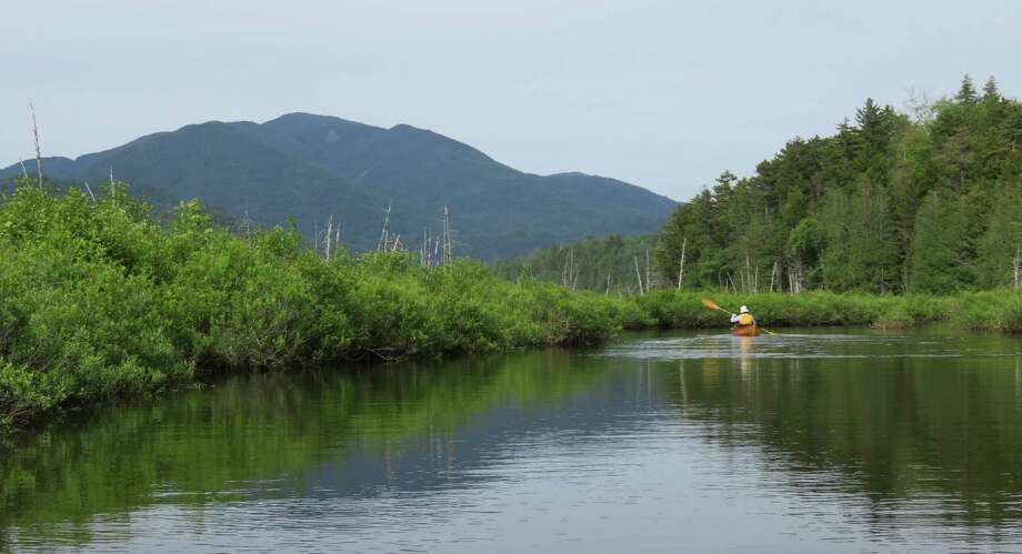Paddling out of Santanoni Brook with Mount Marshall in the background. (Herb Terns / Times Union) Photo: Picasa