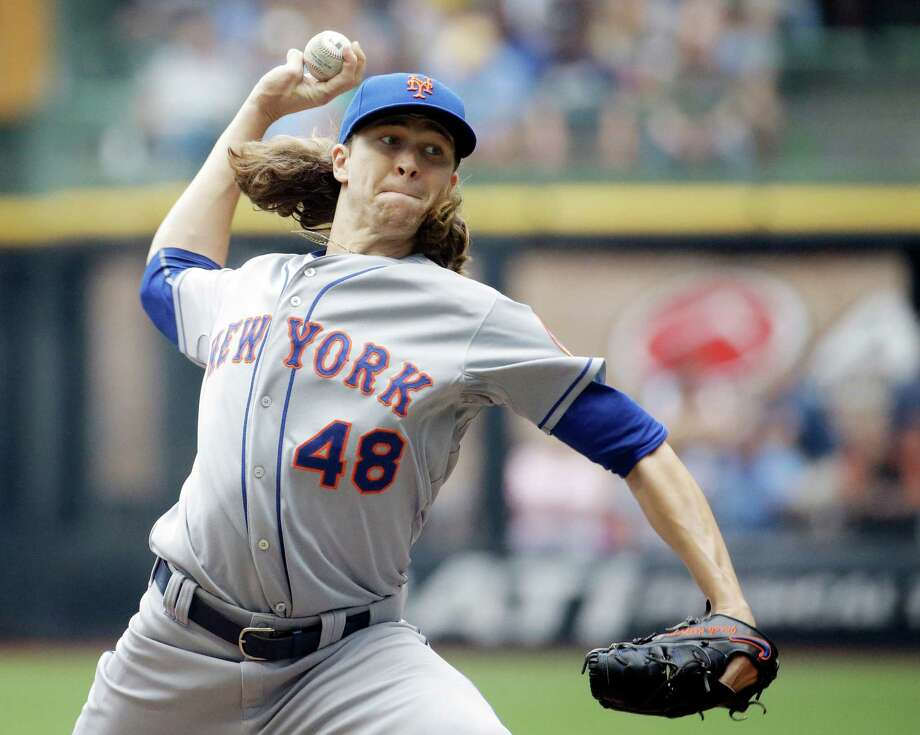New York Mets starting pitcher Jacob deGrom throws during the first inning of a baseball game against the Milwaukee Brewers Thursday, June 25, 2015, in Milwaukee. (AP Photo/Morry Gash) ORG XMIT: WIMG103 Photo: Morry Gash / AP