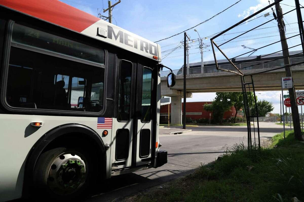 A handicap-accessible metro bus stops along Main Street near the Casa de Amigos Health Center north of downtown Houston.