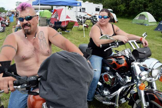 Husband and wife Chris, left, and Shannon Nassa of Raymond, Maine on their Harley Davidsons at The Harley Rendezvous during the annual three day event Thursday June 25, 2015 in Duanesburg, NY.  (John Carl D'Annibale / Times Union) Photo: John Carl D'Annibale / 00032261A