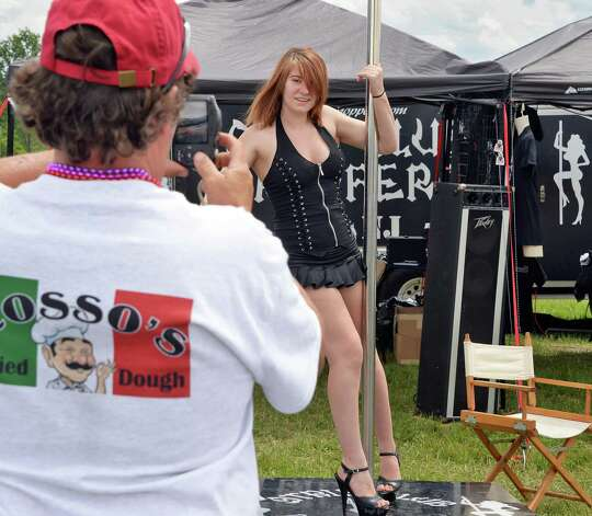 Keith Allen of Oneonta photographs dancer Bethany Wise of Strip Club Choppers at The Harley Rendezvous during the annual three day event Thursday June 25, 2015 in Duanesburg, NY.  (John Carl D'Annibale / Times Union) Photo: John Carl D'Annibale / 00032261A