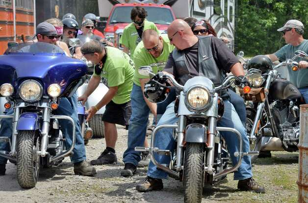 Motorcyclists pass through the search area at The Harley Rendezvous for the annual three day event Thursday June 25, 2015 in Duanesburg, NY.  (John Carl D'Annibale / Times Union) Photo: John Carl D'Annibale / 00032261A