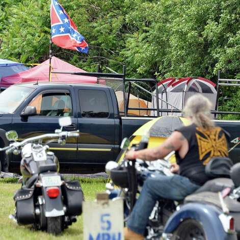 A Rebel flag flies over a campsite at The Harley Rendezvous for the annual three day event Thursday June 25, 2015 in Duanesburg, NY.  (John Carl D'Annibale / Times Union) Photo: John Carl D'Annibale / 00032261A