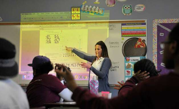 Fifth grade math teacher Sarah Appell works with students in class at KIPP Tech Valley middle school on Tuesday, March 31, 2015, in Albany, N.Y.  (Paul Buckowski / Times Union) Photo: PAUL BUCKOWSKI / 00031207A