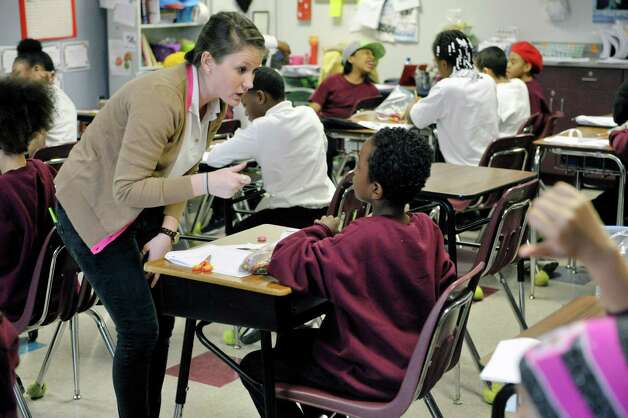 Fifth grade science teacher, Meagan Donovan works with a student in class at KIPP Tech Valley middle school on Tuesday, March 31, 2015, in Albany, N.Y.  (Paul Buckowski / Times Union) Photo: PAUL BUCKOWSKI / 00031207A