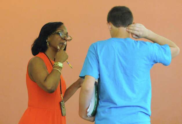 Principal Kimberly Young Wilkinson talks with an eighth grade student at Myers Middle School Friday May 8, 2015 in Albany, N.Y. (Michael P. Farrell/Times Union) Photo: Michael P. Farrell / 00031733A