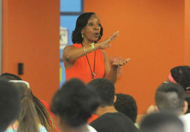 Principal Kimberly Young Wilkinson talks with an eighth grade students about educational performance at Myers Middle School Friday May 8, 2015 in Albany, N.Y. (Michael P. Farrell/Times Union) Photo: Michael P. Farrell / 00031733A
