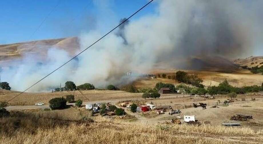 Smoke billows from the 53-acre Tesla Fire, which damaged a home, injured a firefighter and destroyed a barn and a vehicle near Livermore on Thursday, June 26, 2015. Photo: Courtesy, Alameda County Fire Department