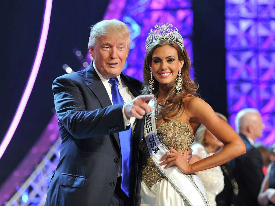"""FILE - In this June 16, 2013 file photo, Donald Trump, left, and Miss Connecticut USA Erin Brady pose onstage after Brady won the 2013 Miss USA pageant in Las Vegas, Nev. Univision says it is dropping the Miss USA Pageant and says it will cut all business ties with Donald Trump over comments he made about Mexican immigrants. The network said Thursday, June 25, 2015, it will not air the pageant on July 12, as previously scheduled, and has ended its business relationship with the Miss Universe Organization due to what it called """"insulting remarks about Mexican immigrants"""" by Trump, a part owner. (AP Photo/Jeff Bottari, File) ORG XMIT: NYET403 Photo: Jeff Bottari / AP"""