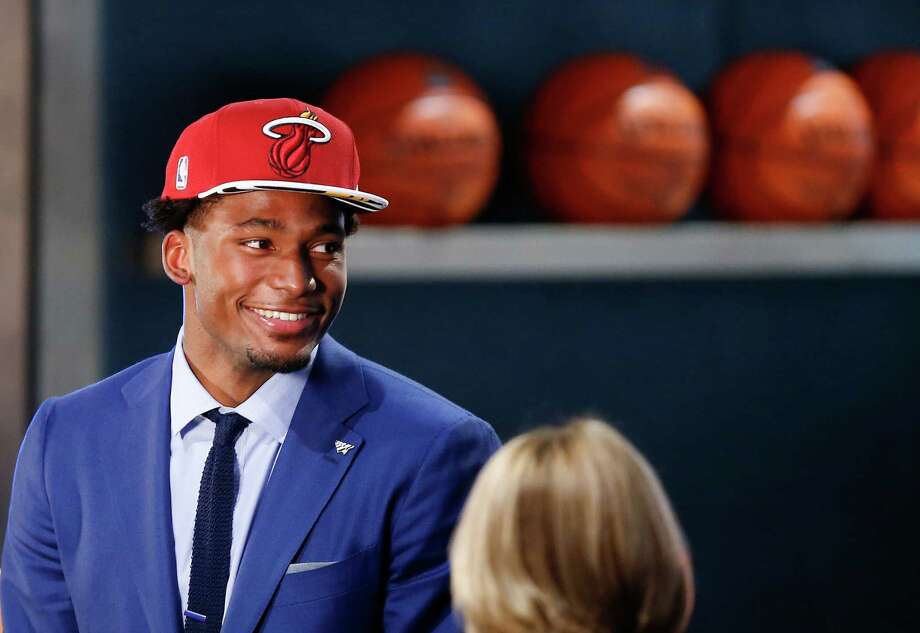 Projected to perhaps go higher in the NBA draft, Justise Winslow couldn't mask his delight at being selected by the Heat with the No. 10 pick. Photo: Kathy Willens, STF / AP