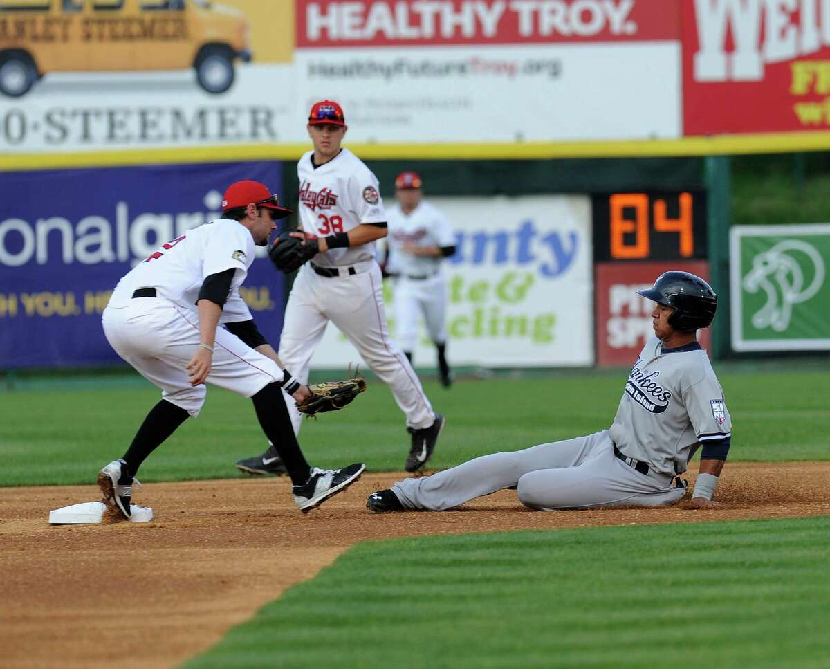 Tri-City ValleyCats Keach Ballard ,left, tags out Staten Island Yankees Thairo Estrada at second base during their home opener baseball game at Joe Bruno Stadium in Troy, N.Y., Thursday, June 25, 2015. (Photo/Hans Pennink) ORG XMIT: HP105