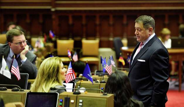 Assembly Majority Leader Joseph Morelle, right, speaks to staff members on the Assembly floor during a lull in the proceedings Thursday afternoon, June 25, 2015, at the Capitol in Albany, N.Y.  (Skip Dickstein/Times Union) Photo: SKIP DICKSTEIN / 00032391A