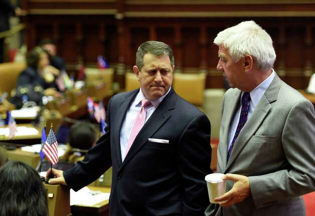 Assembly Majority Leader Joseph Morelle, left, is deep in thought as he listens to Assemblyman Kevin Cahill of Kingston on the Assembly floor during a lull in the proceedings Thursday afternoon, June 25, 2015, at the Capitol in Albany, N.Y.  (Skip Dickstein/Times Union) Photo: SKIP DICKSTEIN / 00032391A